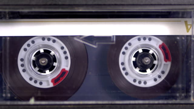 audio tape. vintage tape recorder plays audio cassette inserted therein - cilindro video stock e b–roll