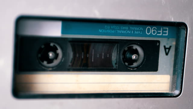 audio tape. vintage tape recorder plays audio cassette inserted therein - bobina apparecchiatura di registrazione del suono video stock e b–roll