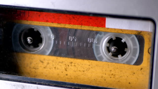 audio tape. vintage tape recorder plays audio cassette inserted therein - cassetta video stock e b–roll