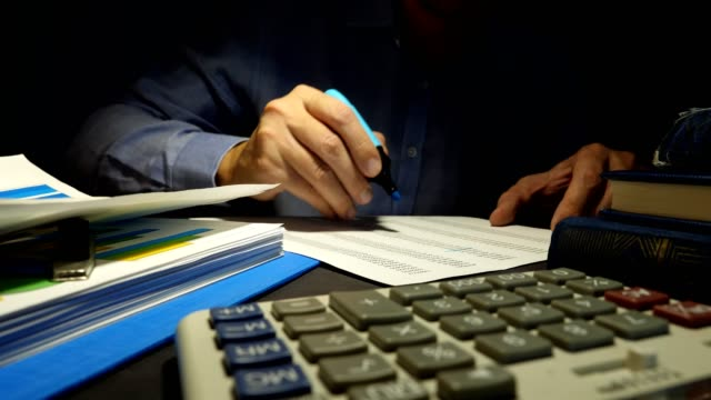 Auditor checks business report at the office. Accountant working with documents. Auditor checks business report at the office. Accountant working with documents. obedience stock videos & royalty-free footage