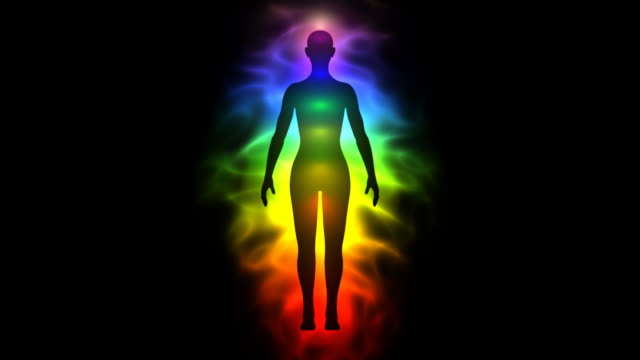 Aura and chakras - silhouette of woman video