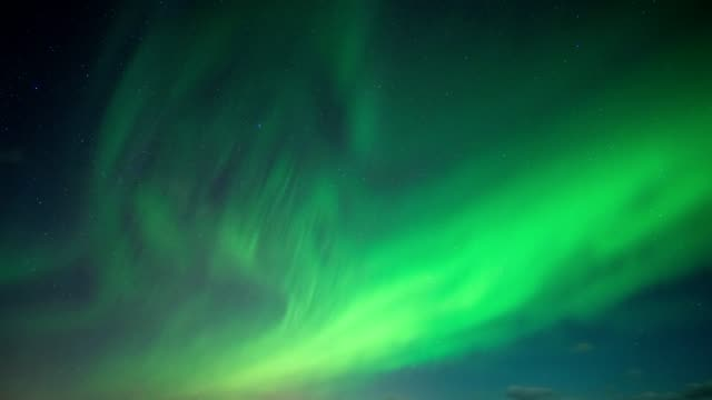 Aurora Borealis, Northern Lights with stars in the night sky on Arctic Circle at North Pole