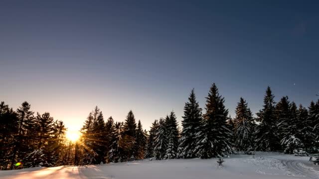 Aurora time lapse in winter mountain