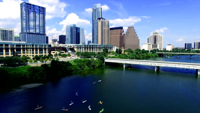 Austin Texas Over Town Lake Kayakers and Canoes and Stand Up Paddle Boards Summertime City Fun video