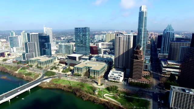 Austin Texas Side Pan high above Town Lake looking at downtown Skyline to Capital view and entire skyline video