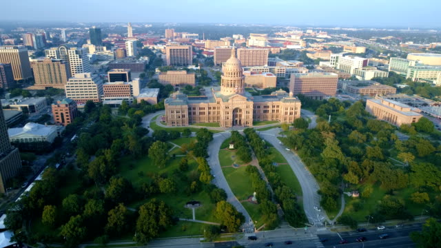 Austin Texas State Capitol building aerial drone view right in front of building video