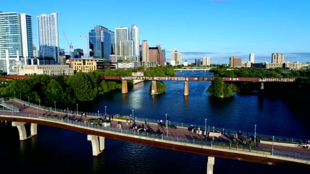 Austin Texas USA Blue Sky Summer Afternoon Crowd of People on Bridge Side pan middle video