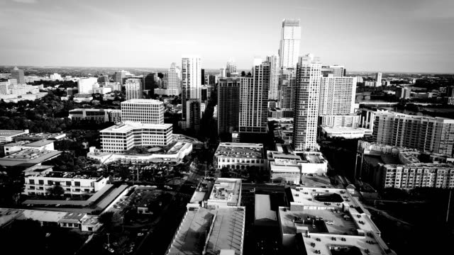 Austin Texas Aerial drone views above downtown Austin Texas USA skyline cityscape in black and white black and white architecture stock videos & royalty-free footage