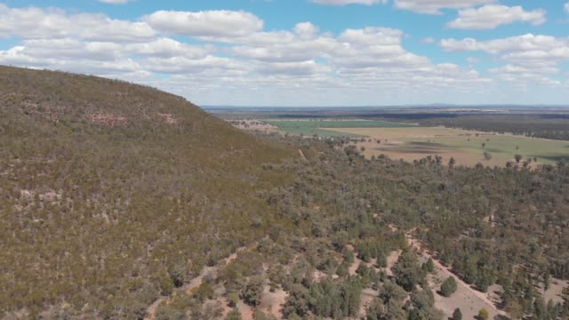 Australia dry outback rural farming and forested landscape Aerial footage video