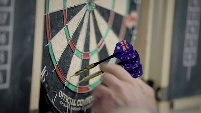 Australian Flag darts being removed from a dartboard Darts with an Australian flag design are removed from a dartboard during a competition.  4k. competition group stock videos & royalty-free footage