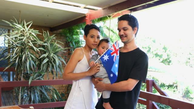Australian Flag Waving Young Happy Aboriginal Family video