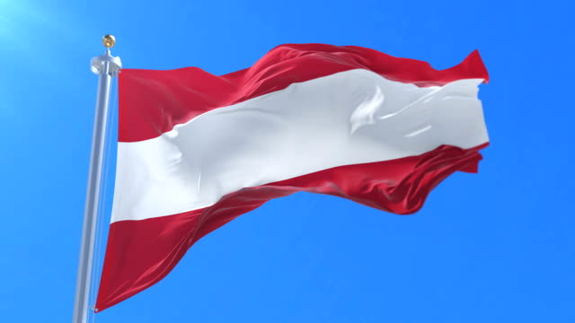 Austria flag waving at wind with blue sky, loop video