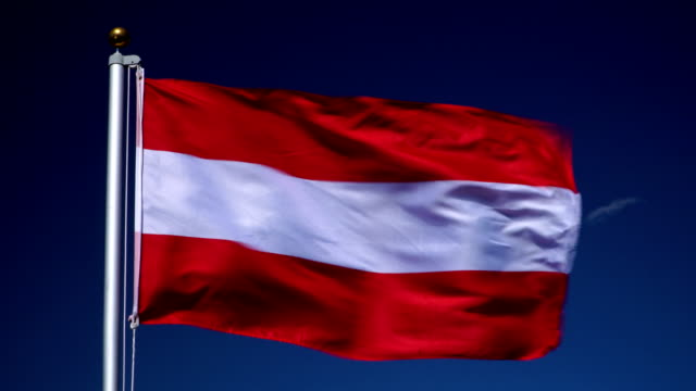 4K: Austrian Flag on Flagpole in front of Blue Sky outdoors (Austria) video