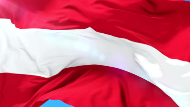 Austrian flag waving at wind with blue sky, loop video