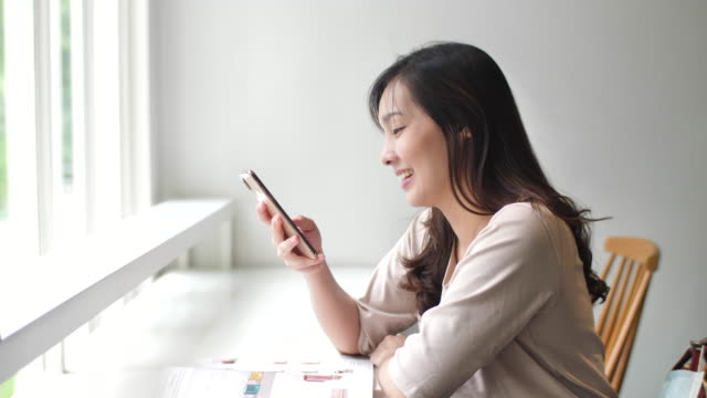 Authentic woman using phone in cafe