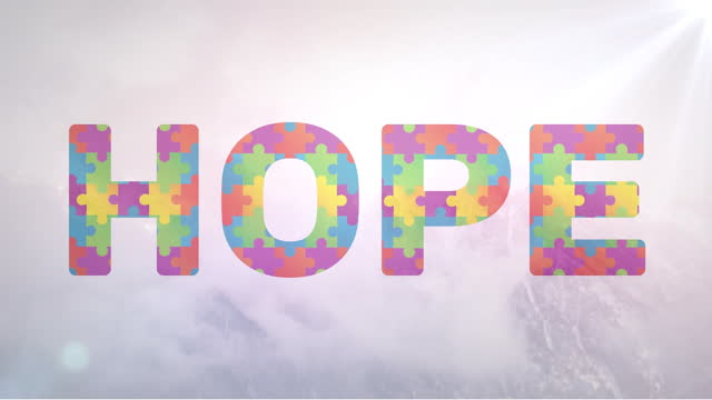 Autism awareness Hope text out of jigsaw Digital animation of multicolor jigsaw puzzle pieces forming Hope text against white background. Autism Awareness concept. typescript stock videos & royalty-free footage