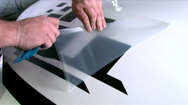 Auto Custom Tuning Car Vinyl Wrap Custom auto graphics tuning process. How to customize your car with stickers.  wrapped stock videos & royalty-free footage