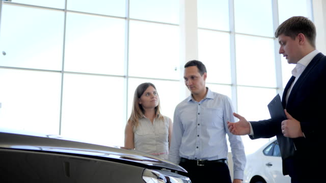 Auto dealer sale car, Family in car dealership, happy people buying automobile, Showroom, car seller Showing consumer New Car video