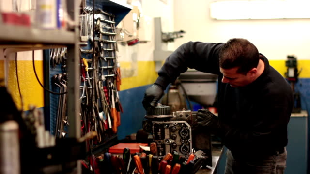 Auto mechanic repairs a motor video