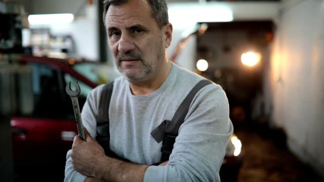 Auto mechanic standing in workshop video