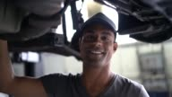 istock Auto service latin afro worker / owner 1128445982