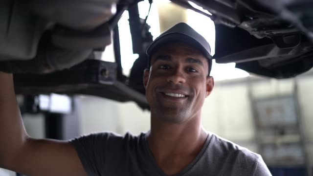 Auto service latin afro worker / owner