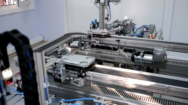 automated car is looping on production line from loading station to unloading station in smart factory