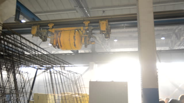 Automated cement block moves on rails video