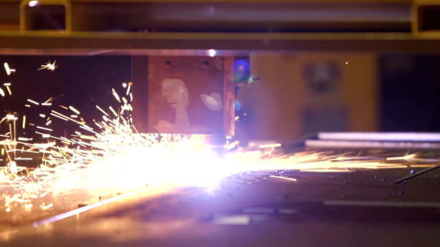 Automated laser cutter cuts through metal video