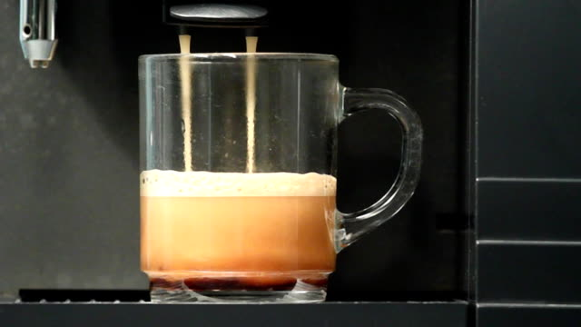 Automated machine - filling cup with hot fresh coffee video
