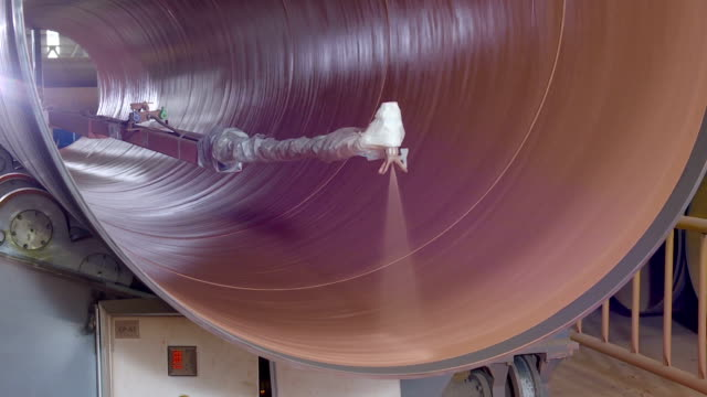 Automated machine is painting the rotating pipe from inside video
