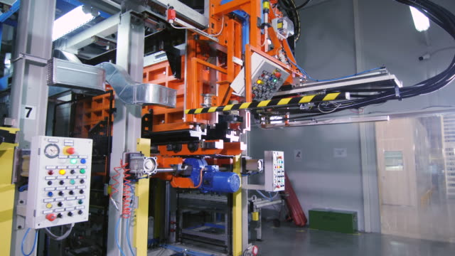 automated machine with control panels in plant workshop