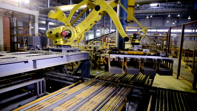 Automated machinery equipment. Robotic arm assembling products, bricks Automated machinery equipment. Robotic arm assembling products, bricks. HD arm stock videos & royalty-free footage