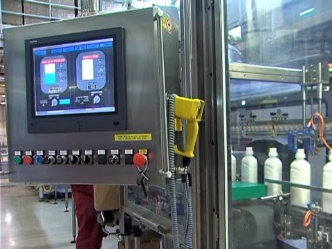 Automated Manufacturing Plastic bottles moving along the conveyor belt dishwashing liquid stock videos & royalty-free footage
