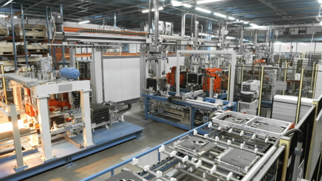 time-lapse automated production line in a factory - automatico video stock e b–roll