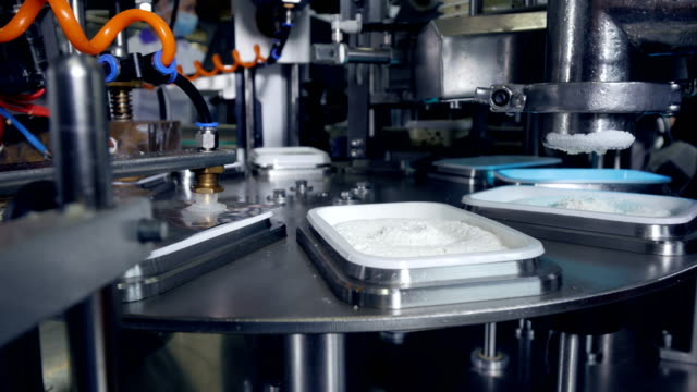 Automated production line of milk products at cheese plant. video