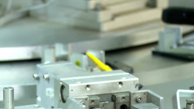 Automated production of plastic parts in a large factory Automated mass production of plastic parts in a large factory computer aided manufacturing stock videos & royalty-free footage