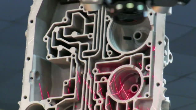 Automated robotic arm peforming 3D laser scanning of a complex interior cast car engine block , in order to produce a computer model of the piece. video