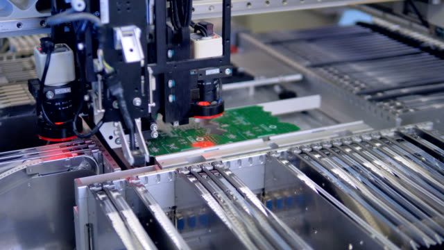 Automated robotics production machine. 4K.