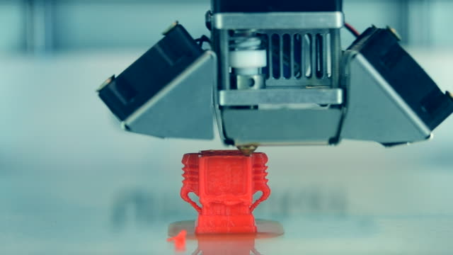 Automatic 3D printer performs plastic modeling in laboratory.
