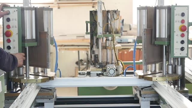 Automatic line machine for sticking together PVC sections of windows and doors in a single frame - finishing process, releasing small window for the next step video
