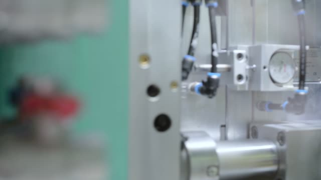 Automatic plastic injection molding machine Automatic plastic injection molding machine. Movement of the mechanism of the molds. molding a shape stock videos & royalty-free footage
