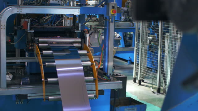 Automatical machine rolling metal sheet in household appliances factory Automatical machine rolling metal sheet in industrial factory. Process production metal parts at plant. Metalworking for manufacturing household appliances metal worker stock videos & royalty-free footage