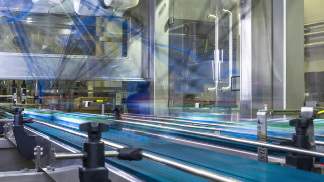 automation production line in milk factory timelapse automation production line in milk factory timelapse 4k conveyor belt stock videos & royalty-free footage