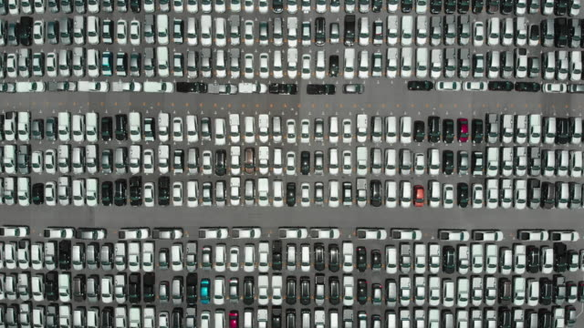 Automobile or logistic business concept : Aerial top down view over plenty amount of vehicle parking in outdoor storage yard waiting for load to freight vessel and export oversea. video