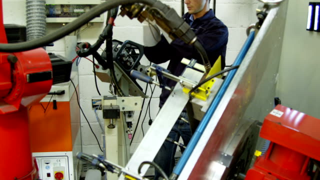 Automotive engineer on quality control duty in a warehouse