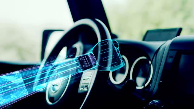Autonomous car. Cyber hand helping on the car steering wheel.
