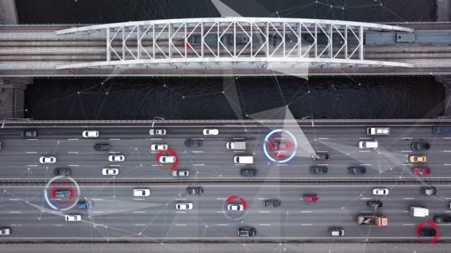 autonomous self driving car moving on highway. futuristic city. intelligence scans environment. safely drives. aerial top view - self driving cars stock videos & royalty-free footage