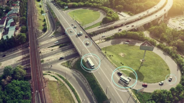 Autonomous Self Driving Cars Concept. Aerial view of cars and buses moving on city intersection and Artificial Intelligence scans road with sensors and control vehicles in traffic. Future Transportation concept video