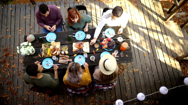 Autumn brunch on the porch Top view of group of friends having brunch on the porch on autumn day table top view stock videos & royalty-free footage